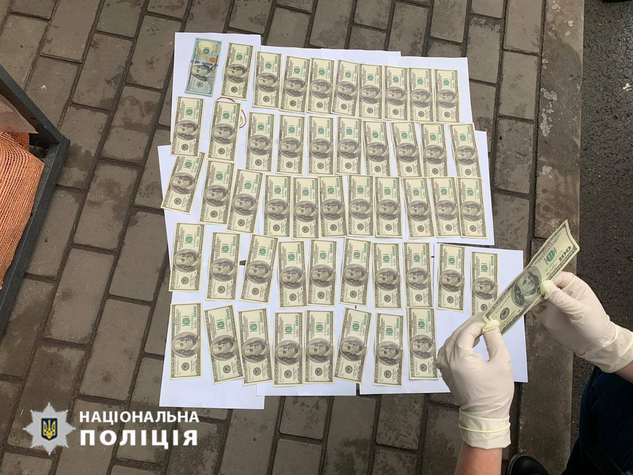 Никопольского полицейского задержали за взятку в 5000 долларов   Прихист